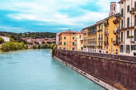 Verona, Italy - June 25, 2017: Scenery with Adige River in Verona with old historical buildings, Italy, Postcard