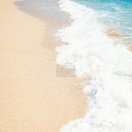 Photo for Sea Beach and Soft wave of blue ocean.  Sandy beach background - Royalty Free Image