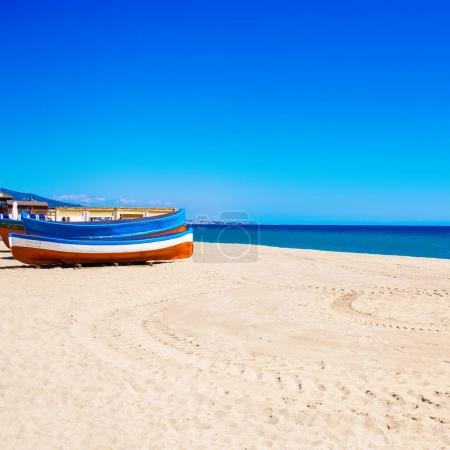Colorful boat and empty beach