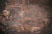 Wood door lock on old vintage ancient wooden background. Old texture of bark wood
