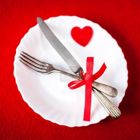 Valentine's day table setting  on red background with copy space