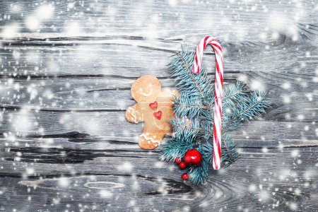 Beautiful Christmas composition with gingerbread cookie, holiday decorations and snow, copy space, magic fairy tale ide
