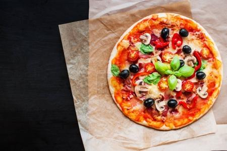 Hot pizza slice with mushrooms, tomatoes, cheese and  basil leaf, flat lay