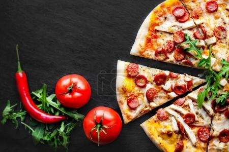 Meat  Pizza with sausage,  mozzarella cheese and t...