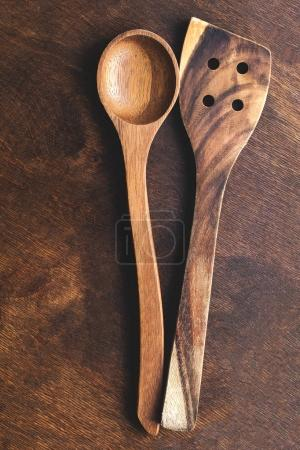 Kitchen wooden utensils over vintage wooden background