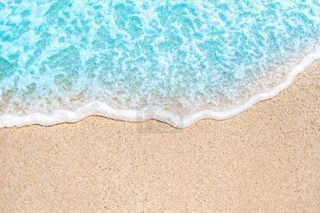 Soft wave of blue ocean on sandy beach