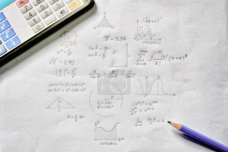 Maths concept - calculator and pencil over sheet of paper with math formulas