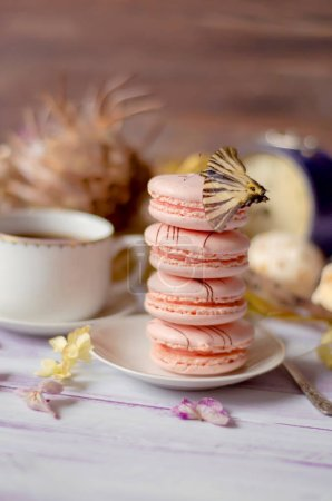 Cup of coffee with macaroons, dried flowers protea