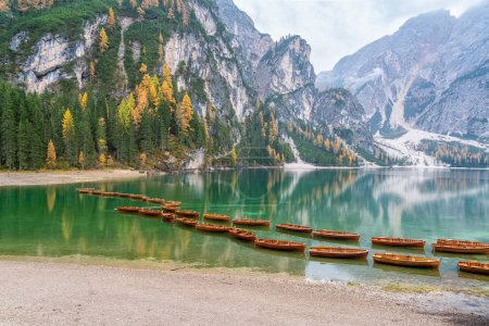 Photo for Foggy autumn morning at Lake Braies, Province of Bolzano, Trentino Alto Adige, Italy. - Royalty Free Image