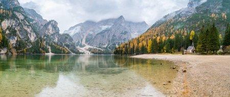 Photo for Foggy autumn morning at Lake Braies, Province of Bolzano, Trentino Alto Adige, Italy. - Royalty Free Image