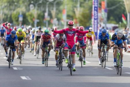 Evgeny Korolek from Belarus Crossing the Finish Line in Front of Peloton During International Road Cycling Competition Grand Prix Minsk-2017