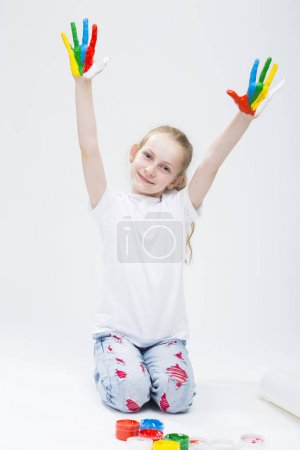 Kids Concepts. Portrait of Smiling Young Girl With LIfted Messy Colorful Palms