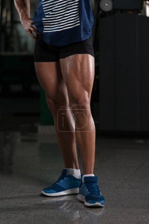 Close-Up of Bodybuilders Legs Ready For Competitiv...