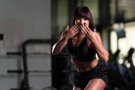 Woman In Gym Sending Kisses