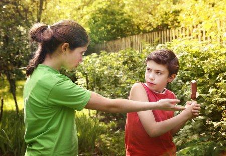teen siblings couple boy and girl quarreling