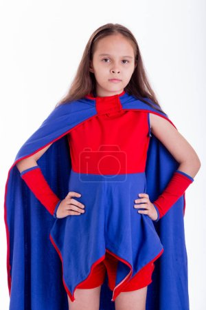Girl in superhero costume with hands on hips