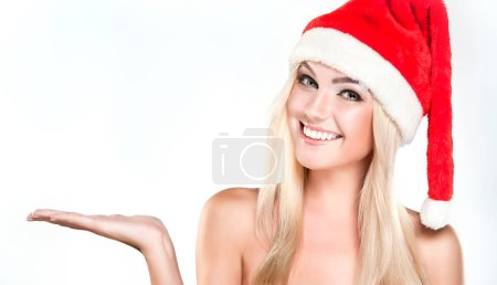 girl in  Santa hat shows  product