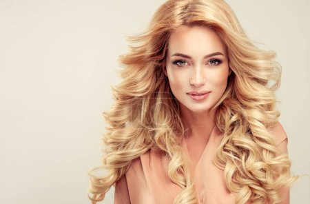Photo for Beautiful girl blonde hair  girl with an elegant hairstyle , hair wave ,curly hairstyle - Royalty Free Image