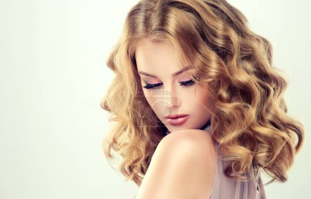 Beautiful model girl with curly hair .