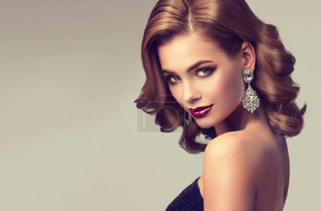 Photo for Beautiful young  woman with make up , hairstyle and  earrings - Royalty Free Image
