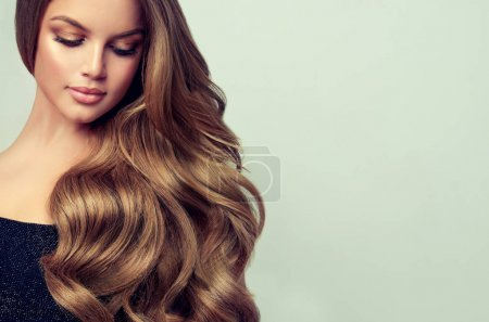 Photo for Beautiful  woman with long and volume shiny wavy hair - Royalty Free Image
