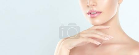 Photo for Beautiful Young Woman with clean fresh skin . Facial treatment . Cosmetology , beauty and spa . - Royalty Free Image
