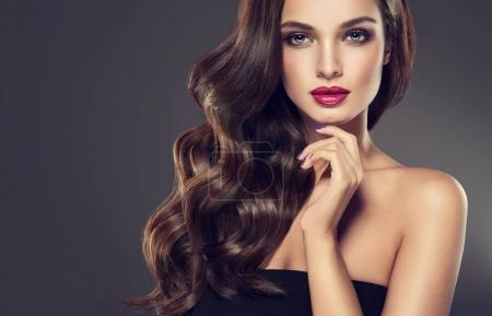 Photo for Beautiful model girl with curly hair  .Young woman with wavy hairstyle - Royalty Free Image
