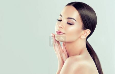 Photo for Beautiful Young Woman with clean fresh skin . Facial treatment . Cosmetology , beauty and spa - Royalty Free Image