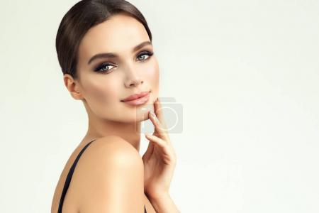 Photo for Beautiful young woman with clean fresh skin, bare sholders and elegant gesture. Close up portrait. Cosmetic, cosmetology and skin care - Royalty Free Image