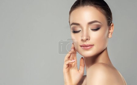 Photo for Beautiful young woman with clean fresh skin. Close up portrait. Cosmetic, cosmetology and skin care - Royalty Free Image