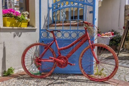Photo for Red Bicycle usage time is over. Now it's just a decor. - Royalty Free Image
