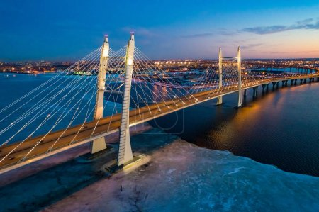 Saint Petersburg. Russia. Bridges Of St. Petersburg. Cable-stayed bridge over the Neva river. Movement of cars on the Obukhov bridge. Panorama of evening St. Petersburg. Gulf of Finland with ice.
