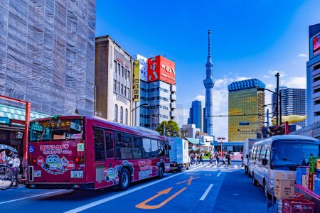 Photo for Tokyo. Japan. Tokyo Tower on the background of blue sky. Panorama of the Japanese city. Highway in the city center. Movement of public transport. Horizon. Japanese architecture. 11.09.2019 - Royalty Free Image