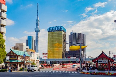 """Photo for Tokyo. Japan. Television Tower in Tokyo. Building of the company """"Asahi"""". Tokyo architecture. Philip Stark architecture. Japan on a summer day. Japan on a background of blue sky. 11.09.2019 - Royalty Free Image"""