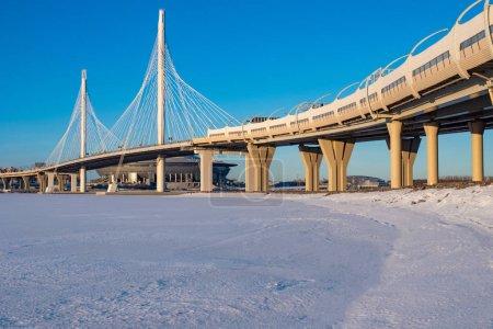 Saint Petersburg. Russia. Bridges Of St. Petersburg. Rivers Of St. Petersburg. The highway passes over the bridge. The cable-stayed Obukhovsky bridge. The Neva river is frozen. Car traffic.