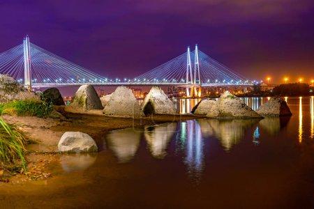 Saint Petersburg. Russia. Neva coast. Big Obukhov bridge. Stones on banks of the Neva. Night Petersburg. Cable-stayed bridge. Tours on the canals of St. Petersburg. City landscape. Cities of Russia