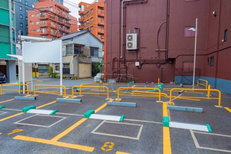 Photo for Japan. Tokyo. Automated car parking in Tokyo. Parking in the middle of city buildings. Empty street parking in Japan. Architecture of Japanese cities. Old buildings in Tokyo. Tourism in Japan. - Royalty Free Image