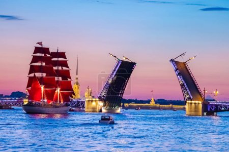 Photo for Saint Petersburg. Russia. White nights in St. Petersburg. Festive Scarlet sails. A ship with scarlet sails on the Neva. Brigantine on the background of the divorced Trinity bridge. Petropavlovskaya - Royalty Free Image