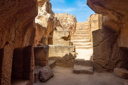 Photo for Republic of Cyprus. Pathos. Royal tombs in Paphos. Tombs of the kings. Ancient steps and grave niches in stone. Archaeological site of Paphos. Tourist attractions of Cyprus. - Royalty Free Image