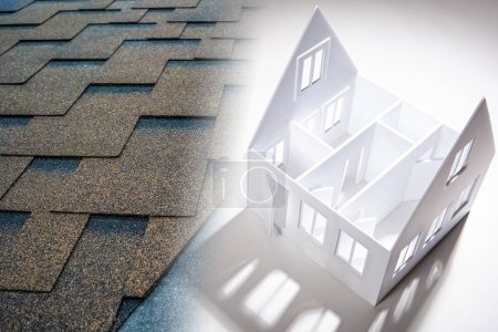 Photo for Roofing material. The use of flexible tiles in construction. A fragment of the tiled roof next to the layout of the house. Layout of a cottage in a construction company. Construction Materials. - Royalty Free Image