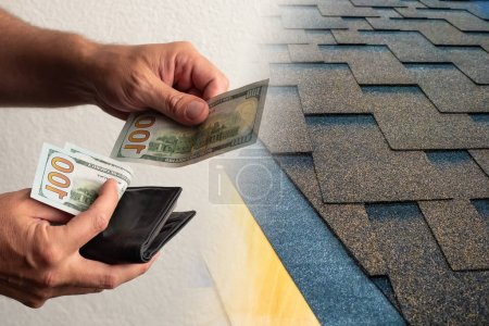 Photo for A man buys tiles. Human will give money to a roofer. Concept - roofer installation business. A man pays for the roofing company. Sale of flexible tiles. Concept - a man is paying in a hardware store - Royalty Free Image