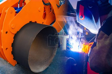 Photo for Replacement of pipes. Large diameter pipe laying machine and welder. Elimination of an accident on an pipeline. Laying new pipes. Repair work. Metal welding. - Royalty Free Image