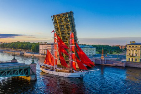 Photo for Saint Petersburg. Russia. A ship with scarlet sails on the Neva. Early morning in St. Petersburg. A sailboat sails under the Trinity bridge. White nights in St. Petersburg. Bridges of Petersburg - Royalty Free Image