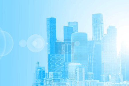 Photo for Blue urban background. Skyscrapers in a soft blue color. The concept of a modern city. Space for text. City buildings of different heights. - Royalty Free Image