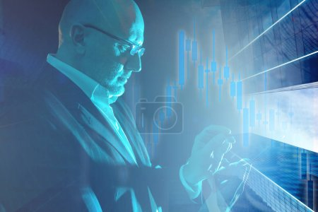 Photo for The concept of exchange trading. Business. Broker on the background of charts and high-rise buildings. A businessman looks over the phone for information about the auction results. - Royalty Free Image