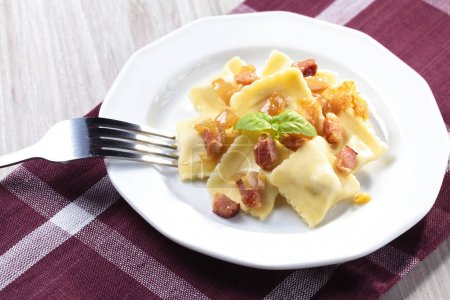 Ravioli with onion and bacon