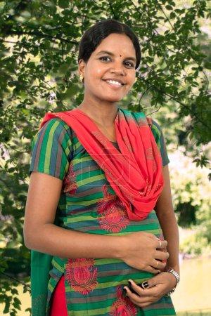 pregnant hindu woman smiling