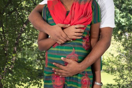 Hindu couple embracing outdoors