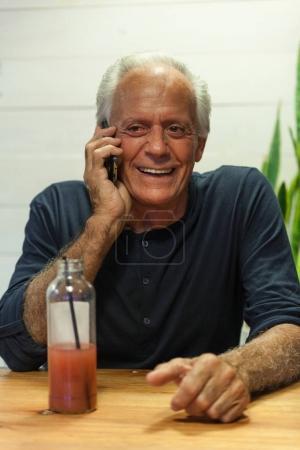 senior talking on cellphone