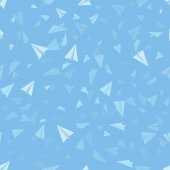 Pattern of paper origami planes on sky blue background